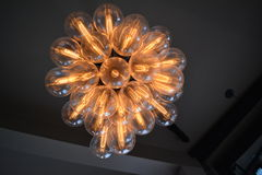 Lamp with cluster of clear bulbs. Lit lamp or ceiling lamp with cluster of light bulbs royalty free stock photography