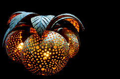 Lamp From Coconuts. Floating lamp made from coconut with carved dots Royalty Free Stock Images