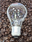 Lamp on the coffee beans. Royalty Free Stock Photos