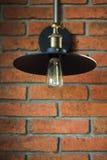 Lamp and cord on  brick wall Royalty Free Stock Photos