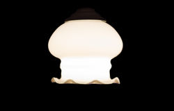 Lamp in the dark. Burning electric lamp hanging in the dark Royalty Free Stock Images