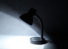 Lamp in the Dark. Desk Lamp on Table in the Dark Room Royalty Free Stock Photography