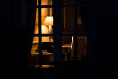 Lamp in the darkness. Light in room at night. Every house has its mystery Royalty Free Stock Photography