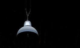 A Lamp in the darkness. A single Lamp in the black darkness Stock Photo