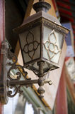 Lamp. Decorative lamp stores on the outer wall Stock Image