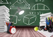 Lamp on Desk foreground with blackboard graphics of math diagrams Stock Image