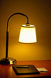 Lamp. Desktop lamp and notepad on desk stock images