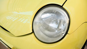 Lamp is dim not clear a font of small car yellow color Stock Image