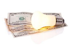 Lamp on dollars background Stock Photos