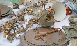 Lamp door and antique chandeliers at flea market Stock Photos