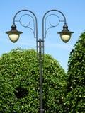 Lamp, double, black, park, day. Lamp, double, black park day bubbles white Stock Photography