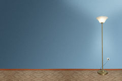 Lamp in empty room Royalty Free Stock Image