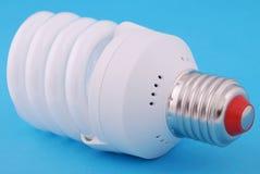 Lamp. Energy-saving electricity lamp. Energy-saving electricity lamp on a blue background Royalty Free Stock Photos