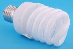 Lamp. Energy-saving electricity lamp. Energy-saving electricity lamp on a blue background Stock Image