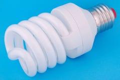 Lamp. Energy-saving electricity lamp. Energy-saving electricity lamp on a blue background Stock Photos