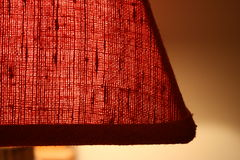 Lamp Fabric. A macro view of the red fabric of a lampshade Stock Images
