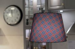 The lamp with a fabric checkered shade in the interior of the kitchen stock photos