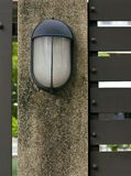 Lamp on fence Stock Images