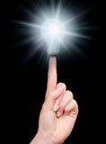Lamp on finger Stock Image