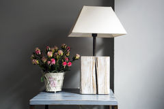 Lamp and flowers on a table Stock Images