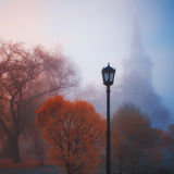 Lamp in fog. Church, fall. Lamp in fog. Red autumn Royalty Free Stock Images