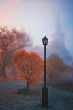 Lamp in fog. Church, fall. Lamp in fog. Red autumn Royalty Free Stock Image