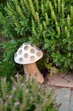 Lamp in the form of a mushroom. The lamp in the form of a mushroom in the bush of mint Royalty Free Stock Photography