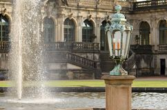 Lamp and Fountain in the Zwinger. A Lamp next to the Fountain in the Zwinger, a Rococo Palace in the City of Dresden Royalty Free Stock Photography