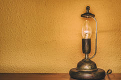 Lamp in front of a wall Stock Images