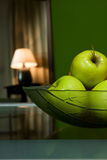 Lamp with fruits. Green room, lamp and fruits in bowl Royalty Free Stock Photography
