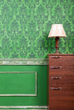 Lamp on furniture in green vintage interior Stock Photos