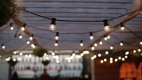 Lamp garlands on roof stock video footage