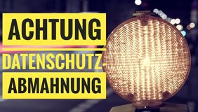 Lamp with in german Achtung Datenschutz-Abmahnung in english attention privacy warning Royalty Free Stock Photos