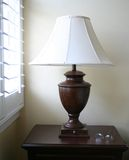 Lamp with glasses. On table with window light Stock Photos