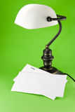 Lamp on green background Royalty Free Stock Photos
