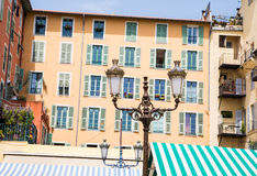 Lamp and Green Striped Awning stock photos