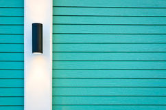 Lamp on green wall Stock Photography