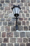 Lamp grunge stone wall background Stock Photo