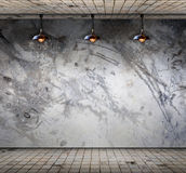 Lamp at Grungy concrete wall with floor tile Royalty Free Stock Image