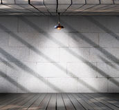 Lamp at Grungy concrete wall with wood floor Stock Photos