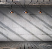 Lamp at Grungy concrete wall with wood floor Stock Image