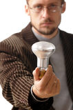 Lamp in hand Stock Photography