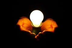 Lamp in hand Stock Photo