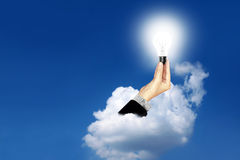 The lamp in hand, businesses Royalty Free Stock Images