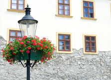 Lamp with hanging flower baskets Stock Photography