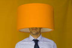 Lamp head businessman. A businessman with a lamp in his head Stock Photos
