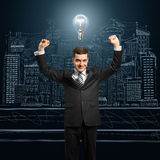 Lamp-head businessman with hands up Stock Photo