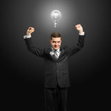 Lamp-head businessman with hands up Stock Photos