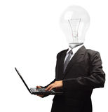 Lamp head businessman holding computer laptop PC Royalty Free Stock Photos