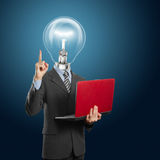 Lamp head businessman with laptop Stock Photography